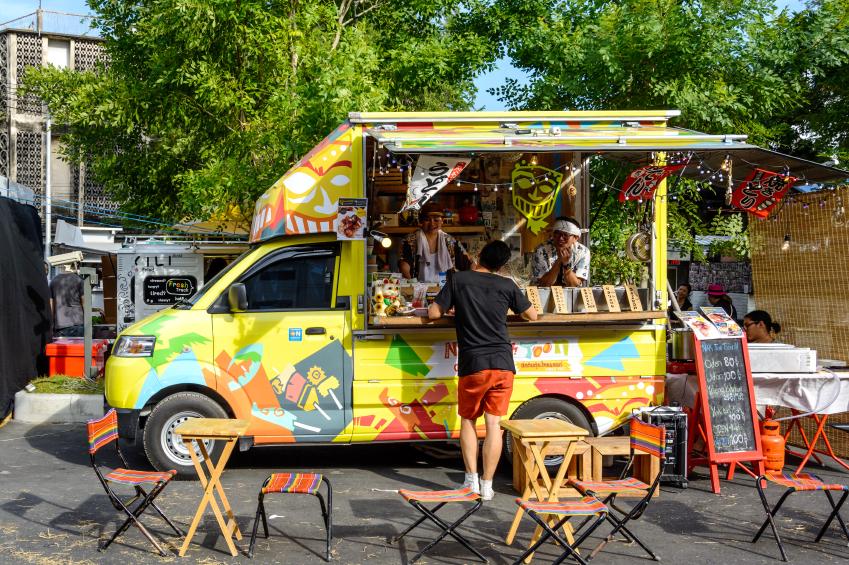 Bangkok, Thailand 25 July,2015: People order meal from food trucks at Food Truck Fair in Bangkok.